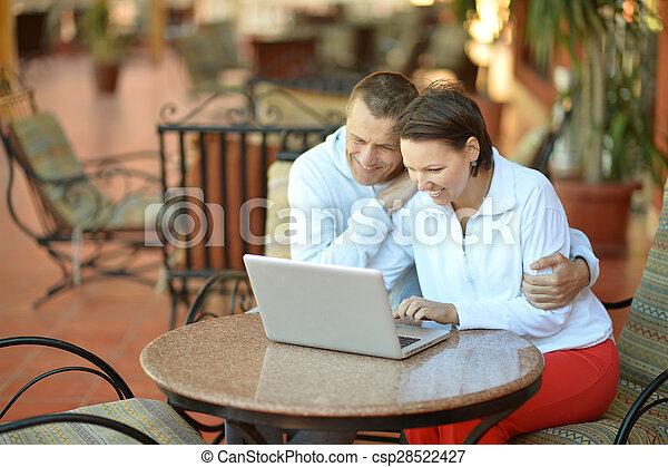 Happy couple with laptop - csp28522427