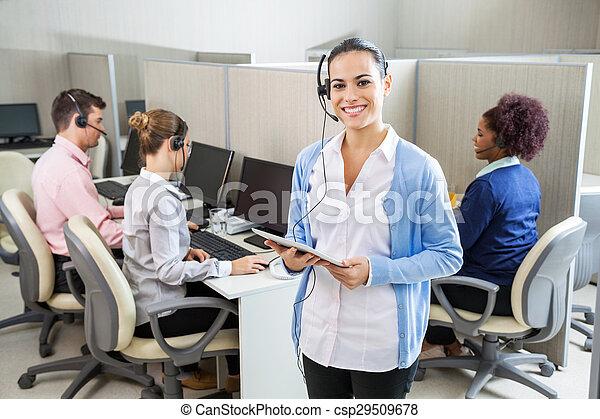 Happy Customer Service Representative Holding Tablet Computer - csp29509678