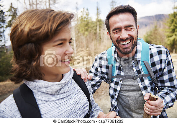 Happy dad and son having a fun during hiking - csp77061203