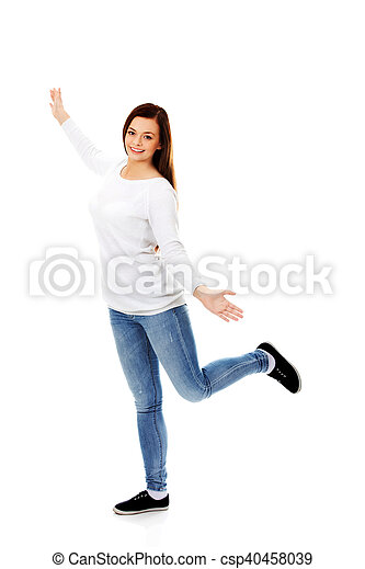 Happy dancing teenager with arms up - csp40458039