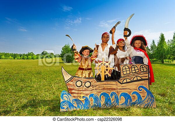 Happy diversity children as pirates with swords - csp22326098