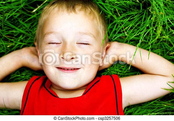 Happy dreaming child on fresh grass - csp3257506