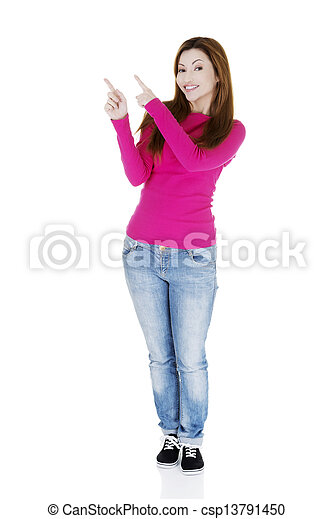 Happy , excited woman pointing on copy space - csp13791450