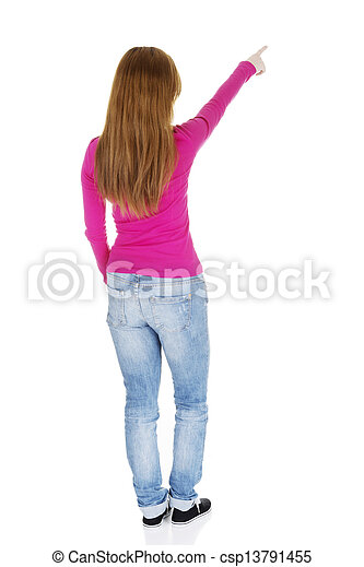 Happy , excited young woman pointing on copy space - csp13791455