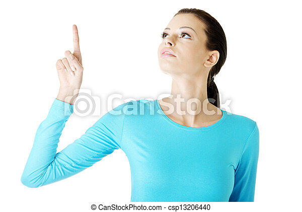Happy , excited young woman pointing on copy space - csp13206440