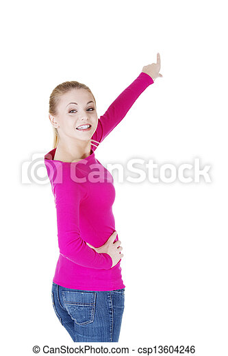 Happy , excited young woman pointing on copy space - csp13604246