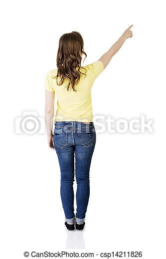 Happy , excited young woman pointing on copy space - csp14211826