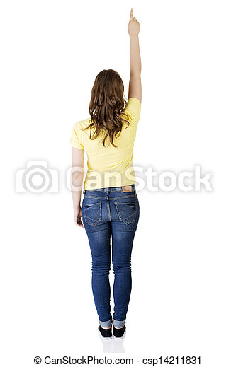 Happy , excited young woman pointing on copy space - csp14211831