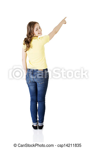 Happy , excited young woman pointing on copy space - csp14211835