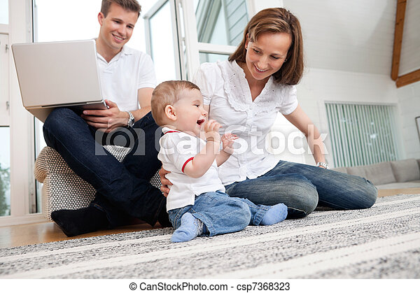 Happy family at home - csp7368323