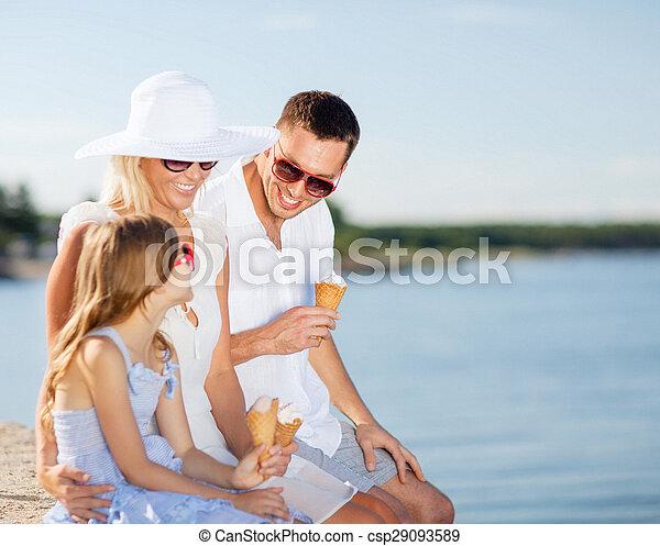 happy family eating ice cream - csp29093589