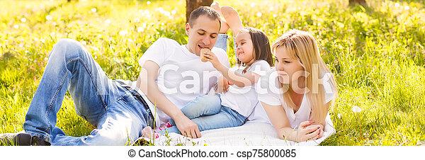 Happy family eating ice cream - csp75800085