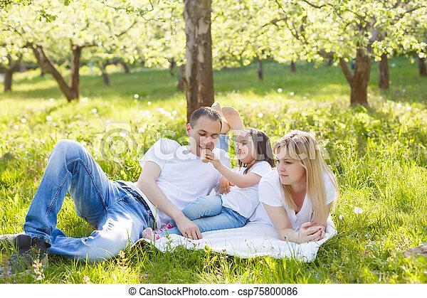 Happy family eating ice cream - csp75800086