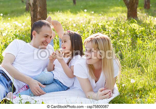Happy family eating ice cream - csp75800087