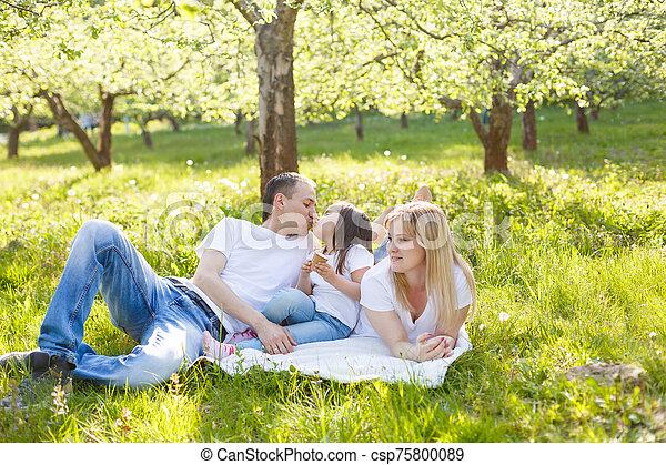 Happy family eating ice cream - csp75800089
