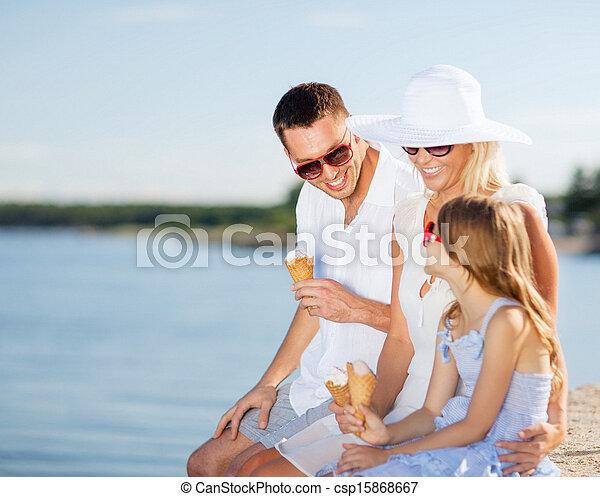 happy family eating ice cream - csp15868667