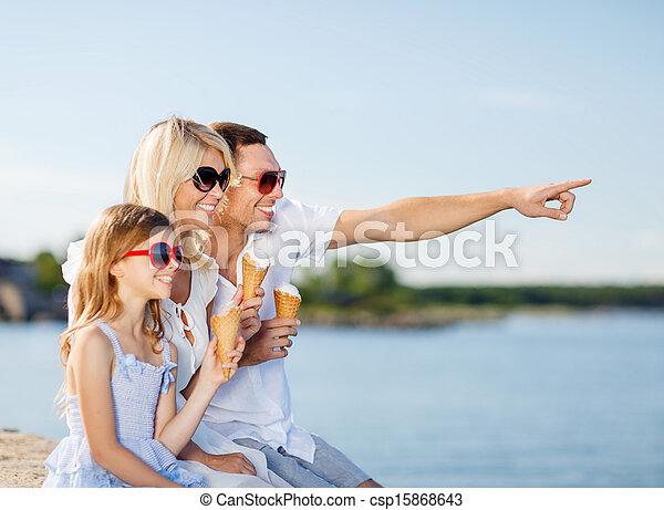 happy family eating ice cream - csp15868643