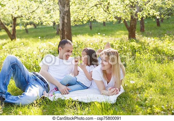 Happy family eating ice cream - csp75800091