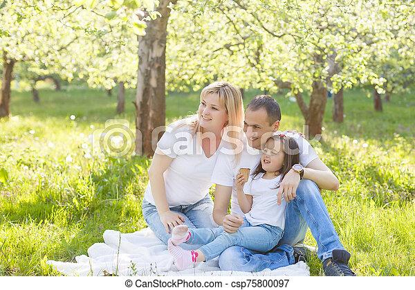 Happy family eating ice cream - csp75800097