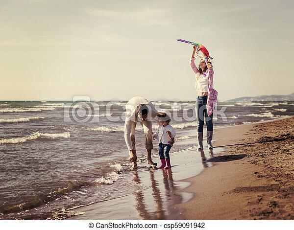 happy family enjoying vecation during autumn day - csp59091942