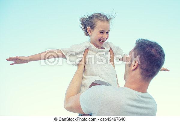 Happy family having fun on the beach. - csp43467640