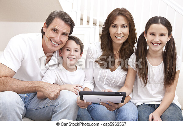 Happy Family Having Fun Using Tablet Computer At Home - csp5963567