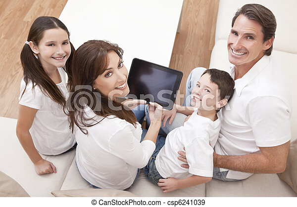 Happy Family Having Fun Using Tablet Computer At Home - csp6241039