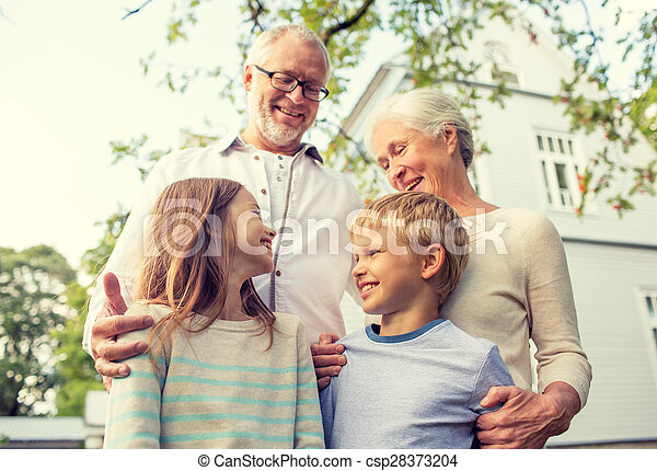 happy family in front of house outdoors - csp28373204