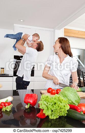 Happy Family in Kitchen - csp7425299