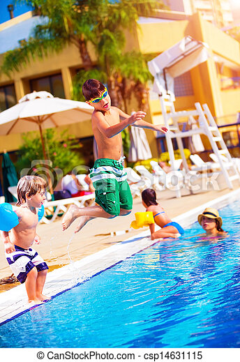 Happy family in the pool - csp14631115