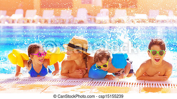 Happy family in the pool - csp15155239