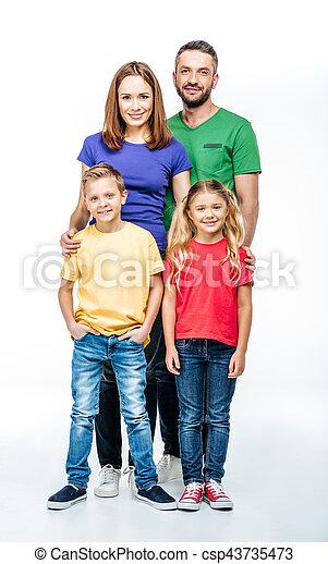 Happy family looking at camera - csp43735473