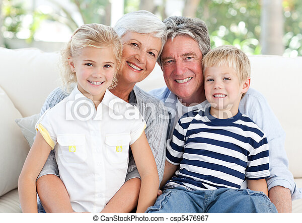 Happy family looking at the camera - csp5476967