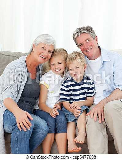 Happy family looking at the camera - csp5477038
