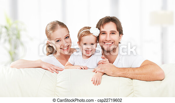 Happy family mother, father, child baby daughter at home on sofa playing and laughing - csp22719602