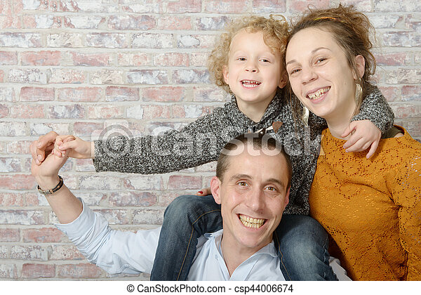 happy family, mother, father, child - csp44006674