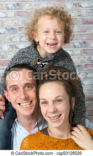 happy family, mother, father, child - csp50128526
