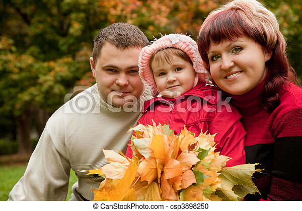 happy family of three persons in the autumn park - csp3898250