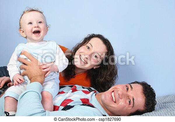 happy family on bed - csp1827690