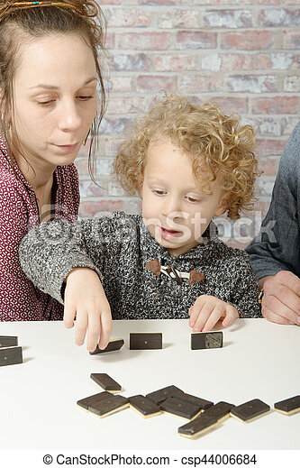 happy family playing dominos - csp44006684