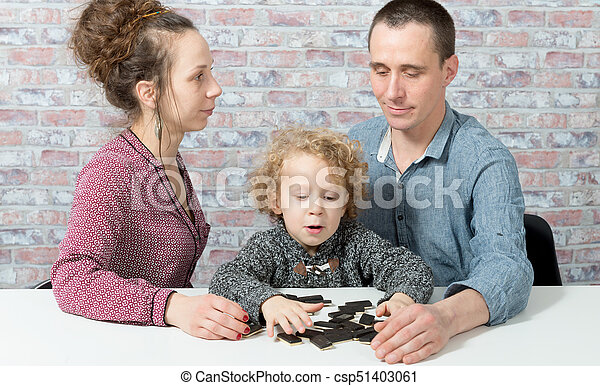 happy family playing dominos - csp51403061