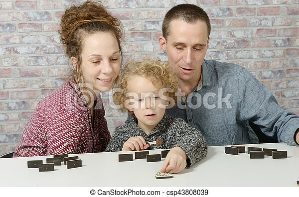 happy family playing dominos - csp43808039