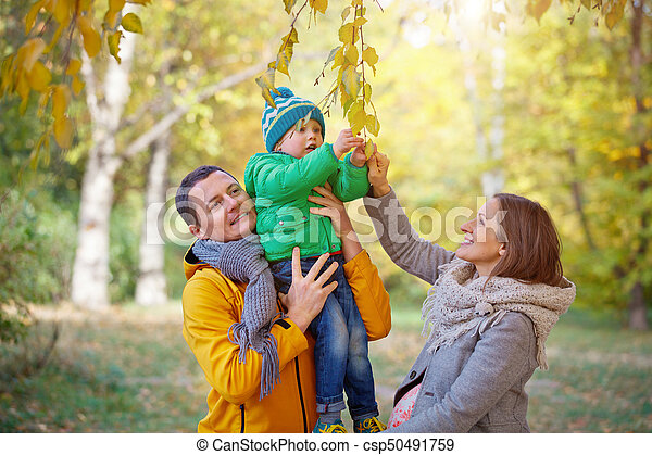 Happy family playing in autumn park - csp50491759