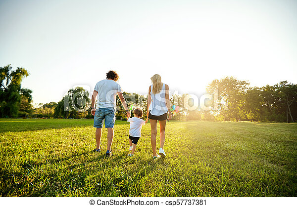 Happy family playing in the park. - csp57737381