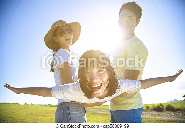 happy family playing on the grass - csp58009199