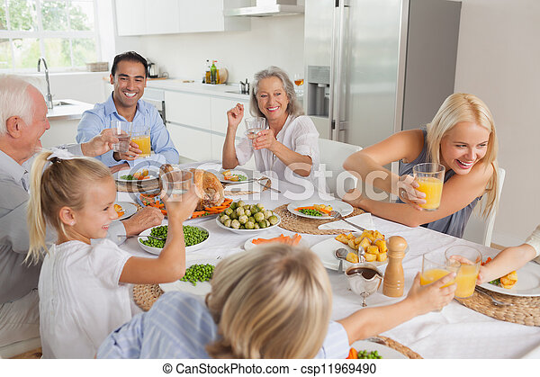 Happy family raising their glasses together - csp11969490
