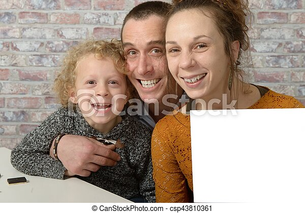 happy family, the mom holding a white sheet of paper - csp43810361