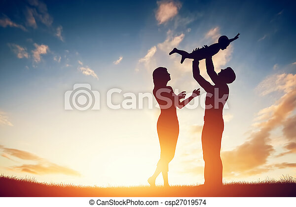 Happy family together, parents with their little child at sunset. - csp27019574