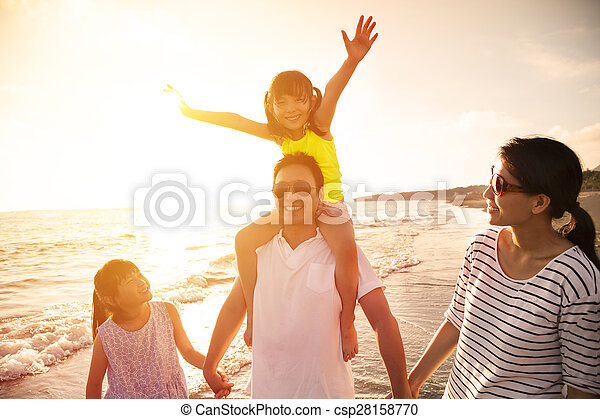 happy family walking on the beach - csp28158770