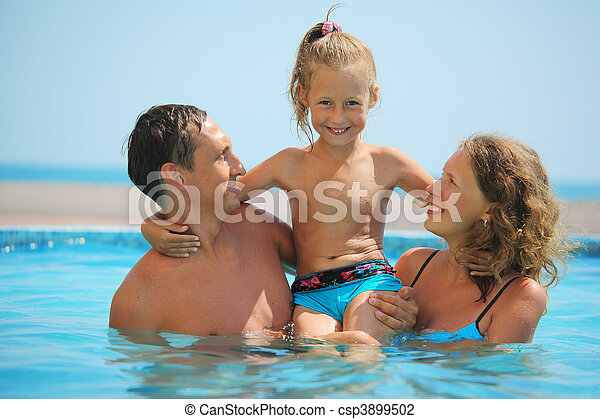 happy family with little girl have fan in pool - csp3899502